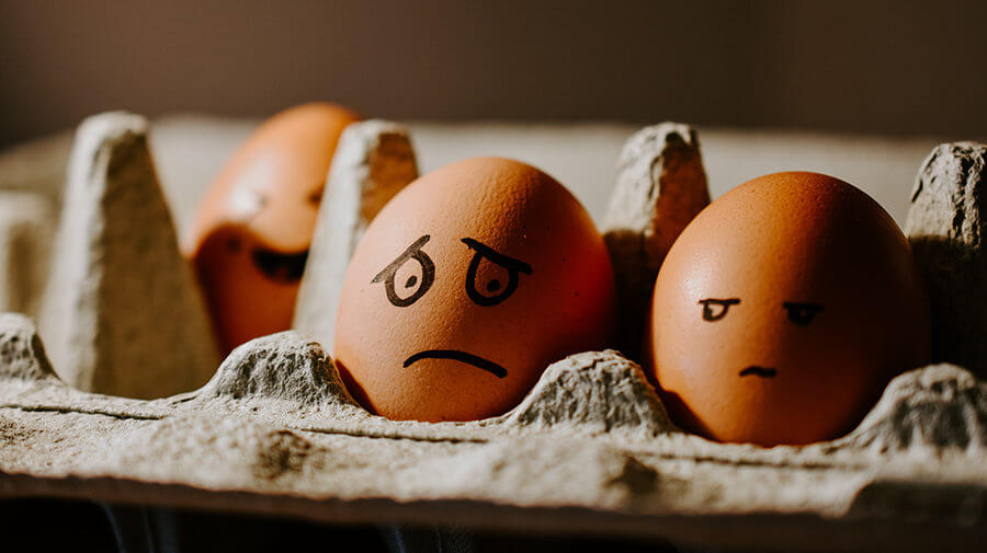 Egg with Mean Face Drawn On it To Reflect Bad Social Media Behavior